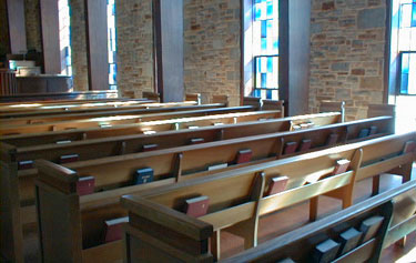 Backs of the pews on the righthand side