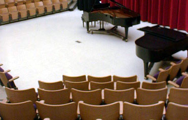 Chairs and stage, seen from audience